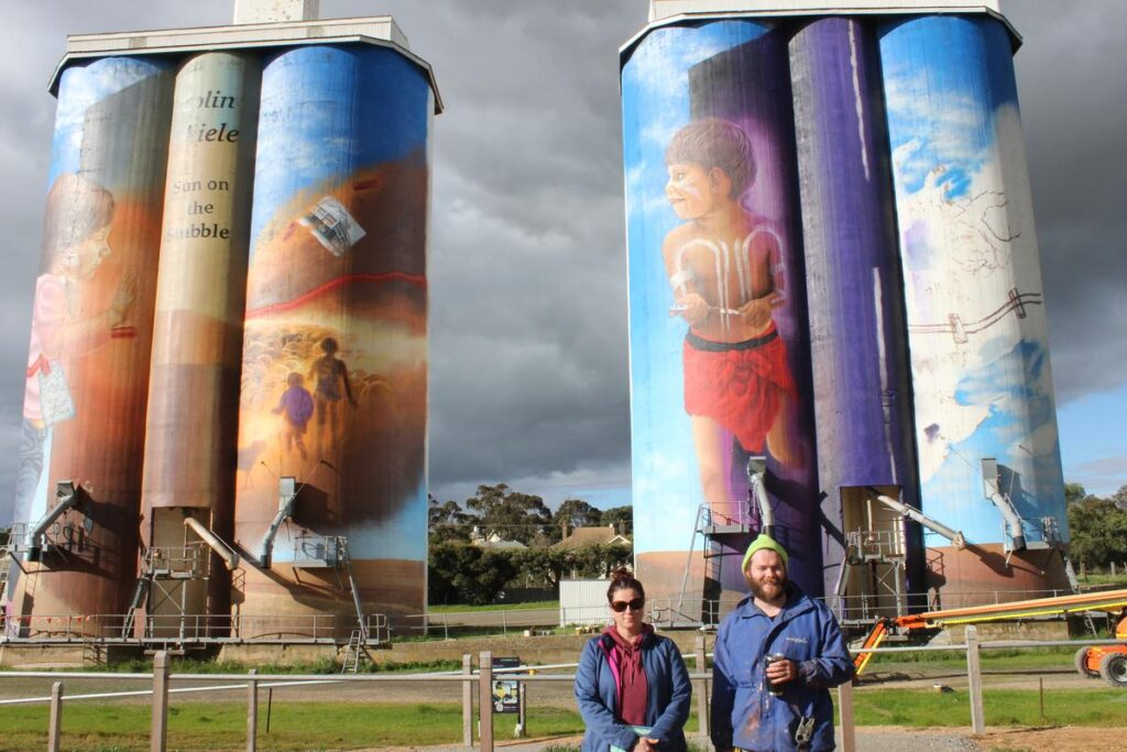 Councillor Debbie Hibbert with Eudunda Silo Artist Sam Brooks taking a brief pause to check his work