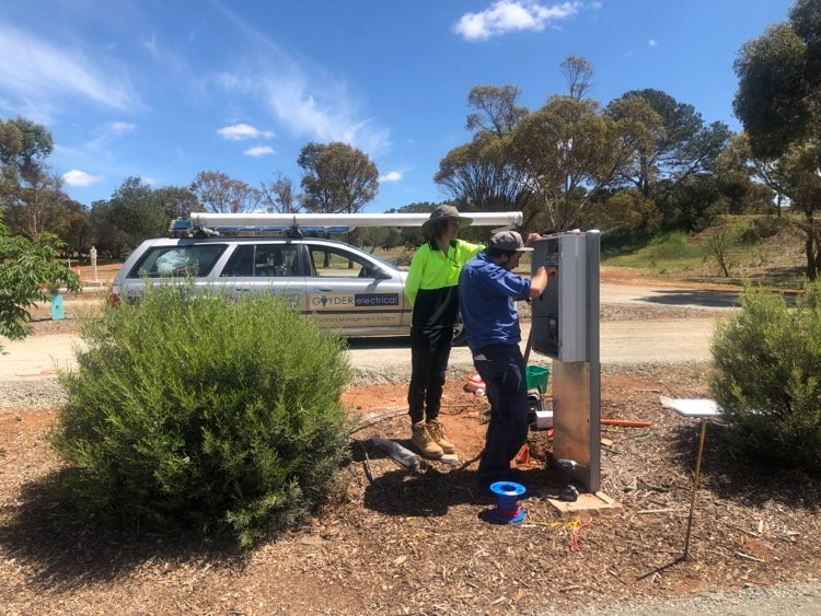 Jarred Schulz of Goyder Electrical and Eudunda Area School Year 11 Work Experience student Jorden Krause Installing equipment at the Eudunda Caravan Park